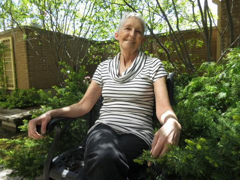 Debbie Leferbe enjoys a moment of relaxation in The Jahnke Family Garden at the London Regional Cancer Program