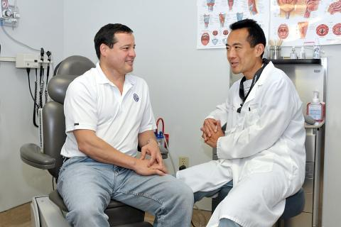 Rod Sinn (left) sits and talks with Dr. Kevin Fung (right)