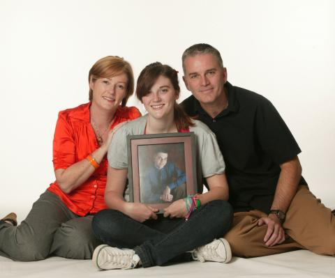 After Josh's tragic passing, his mother Kathryn (left), sister Meg (centre holding a photo of Josh) and father Nigel (right) find comfort in spreading the word about distracted driving