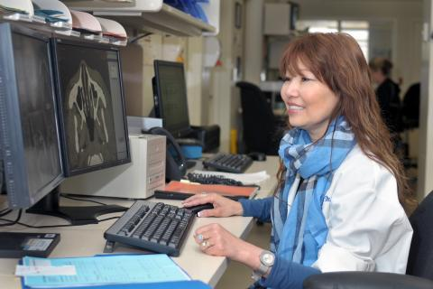 LHSC's Dr. Andrea Lum, Chair/Chief of Diagnostic Radiology, reviews a CT scan