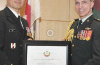 Dr. Kao (left) receives the Chair in Military Critical Care Research from Surgeon General Brigadier-General Jean-Robert Bernier (right) on behalf of the Canadian Armed Forces